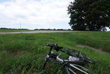Taking a short break in a field with the bike.