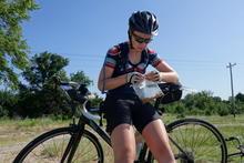 Erin snacking on the bike. Sideways.
